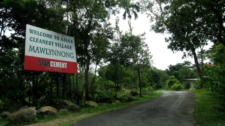 A metal board welcomes you as you take a sharp turn on Khasi hills