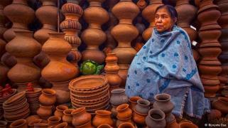 An Ima (in manipuri language 'Mother') selling earthen pots in the market.