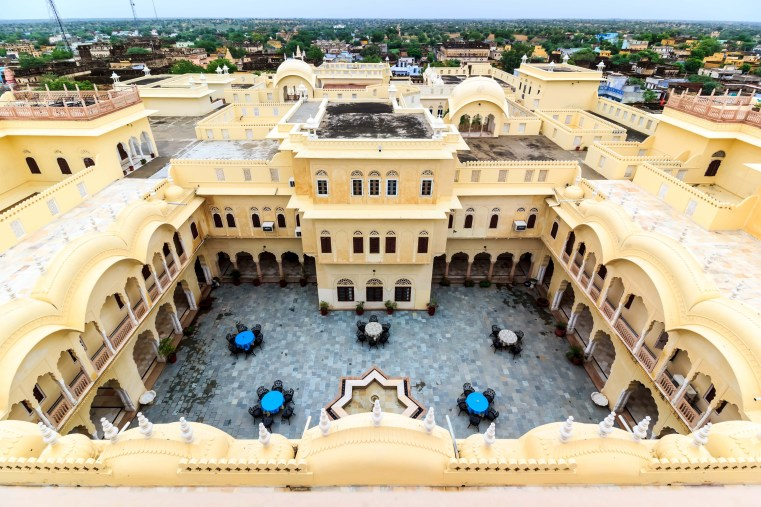 The Alsisar Palace stands like a royal guardian of the village.