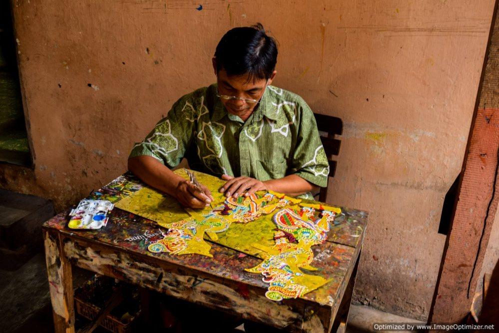Man making world heritage puppets in Yogyakarta
