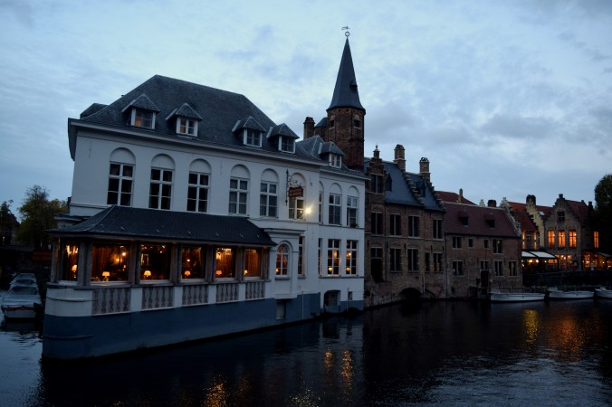 Canals and quays in Bruges, and the elegant views from the seemingly floating restaurants